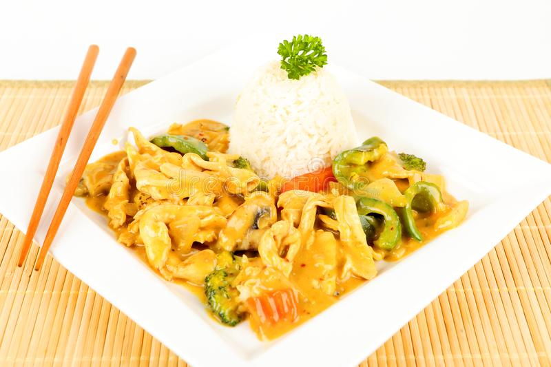 Asian chicken with curry. On a plate royalty free stock photo