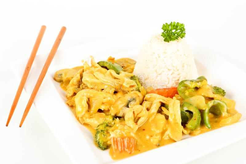 Asian chicken with curry. On a plate stock image