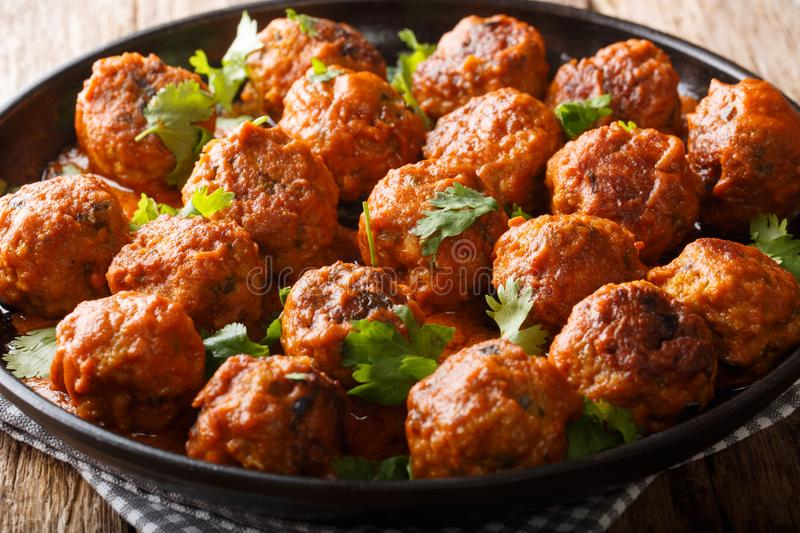 Asian chicken meatballs in a creamy coconut sauce with red curry closeup on a plate. horizontal. Asian chicken meatballs in a creamy coconut sauce with red curry royalty free stock photography