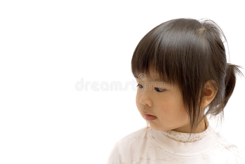 Asian child. Asian cute child with black hair and yellow skin face on white background royalty free stock images