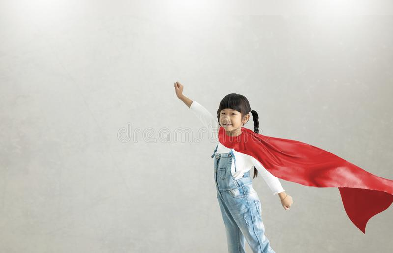 Asian child acting to be superhero.Imanigination and success concept.Play creative thinking in kid stock image