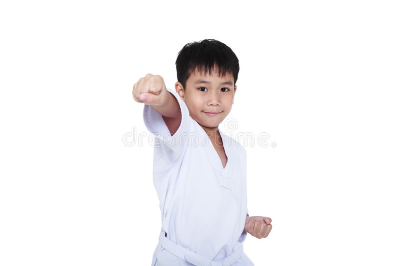 Asian child athletes martial art taekwondo training, isolated on. White background. Cute boy with white belt in karate position, studio shot royalty free stock photos