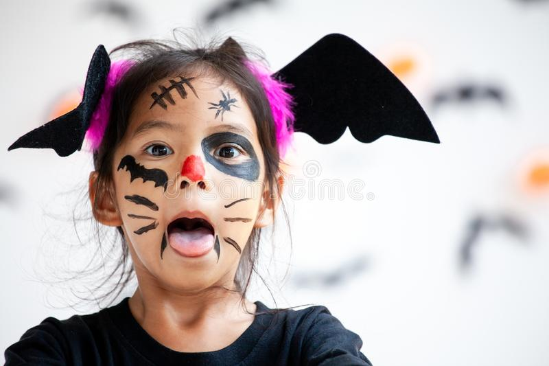 Asian child girl wearing halloween costumes and makeup having fun on Halloween celebration stock images