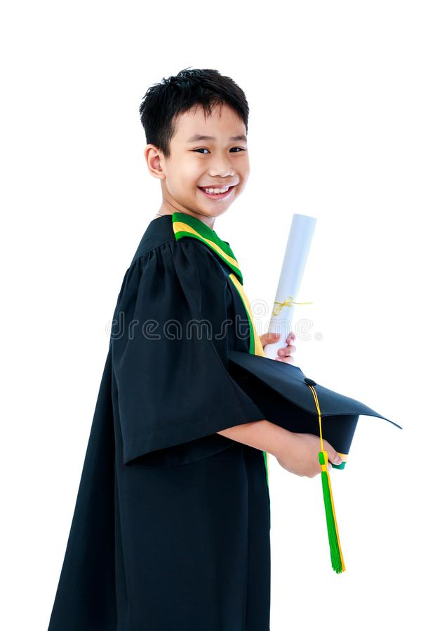 Asian child in graduation gown with diploma certificate and cap royalty free stock photography