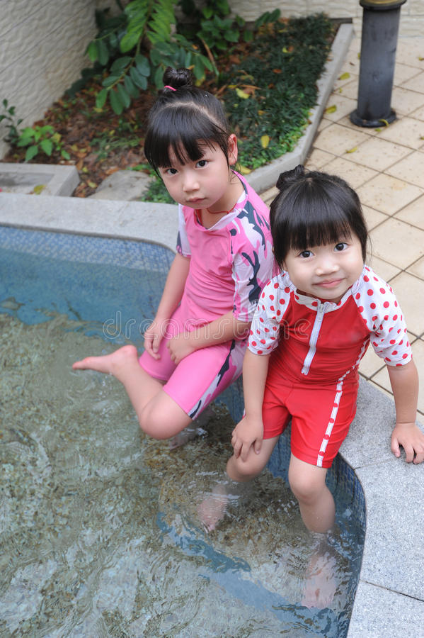 Asian child in Hot spring royalty free stock image