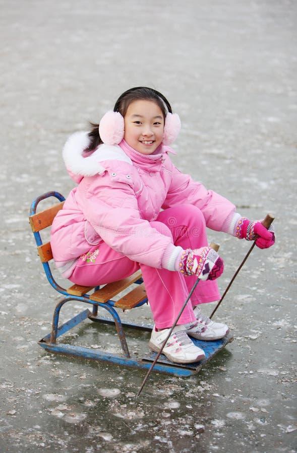 Asian child ice-skating royalty free stock image