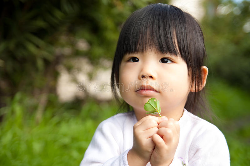 Download Asian Child With A Leaf On Hand Royalty Free Stock Photos - Image: 12799978