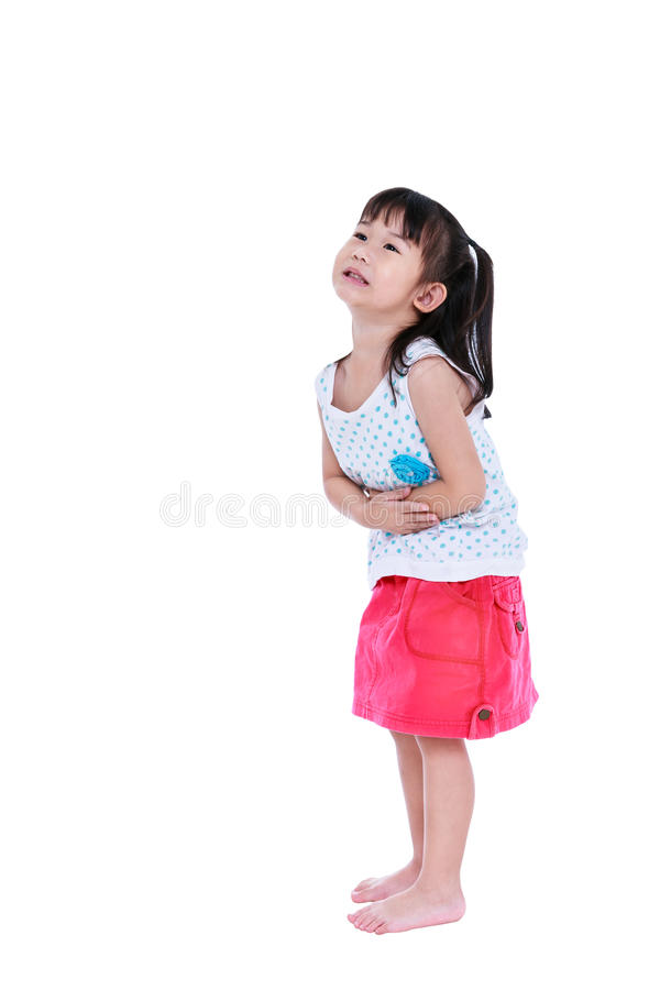Asian child in pink skirt suffering from stomachache. Isolated o royalty free stock photo