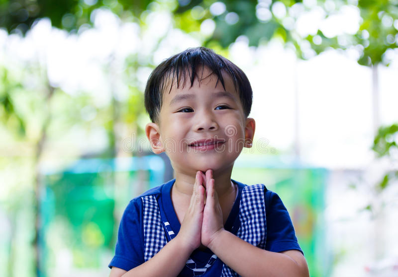 Asian child put the palms of the hands together in salute. stock photos