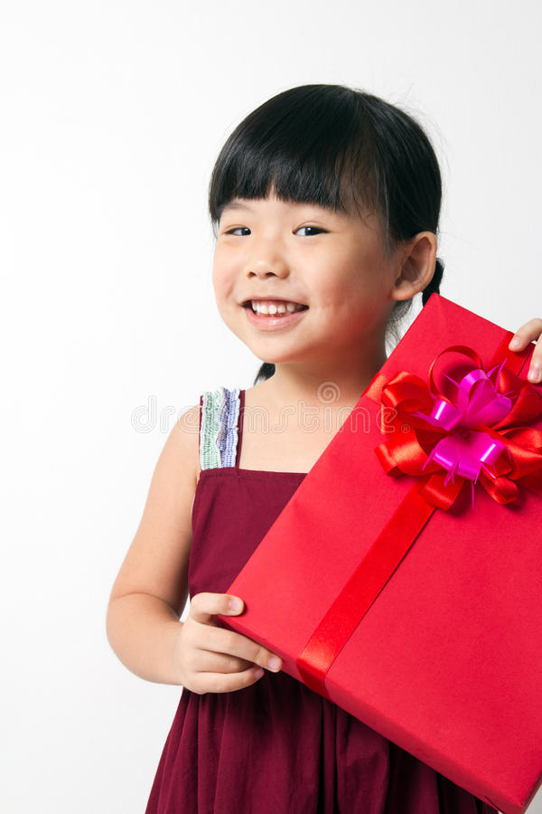 Download Asian Child With Red Gift Box Stock Photo - Image: 27520126