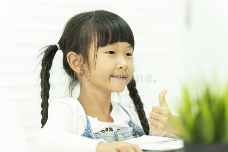 Asian child  Sitting on table and study in school royalty free stock photo