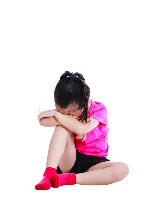 Asian child in sportwear crying. Isolated on white background. stock photography