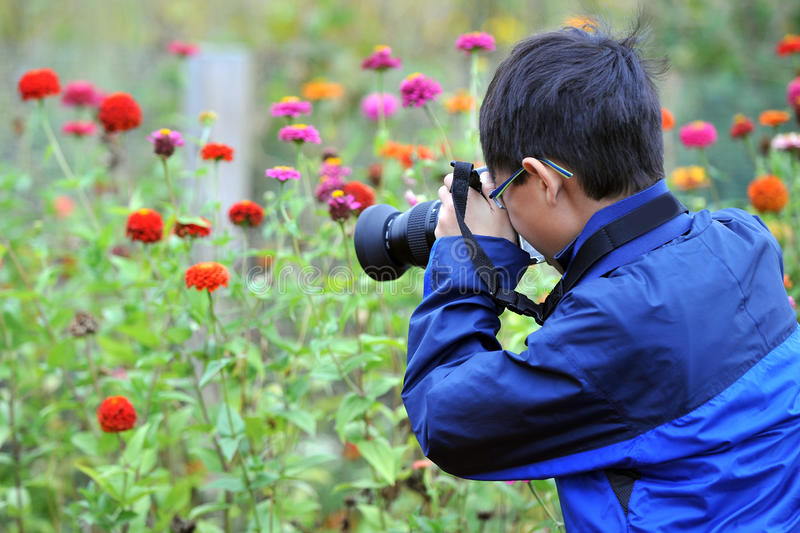 Asian child taking macro picture stock photos