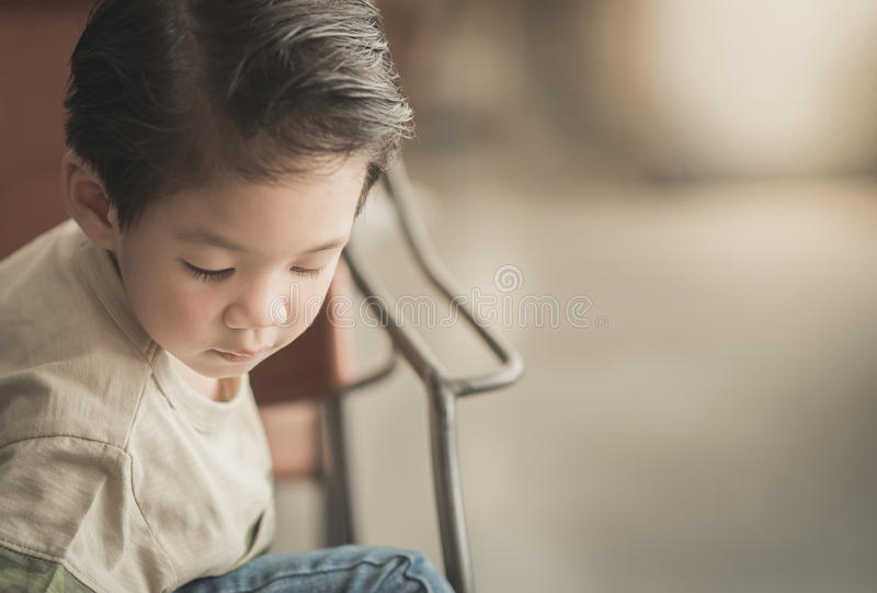 Asian child in a vintage cafe royalty free stock photo