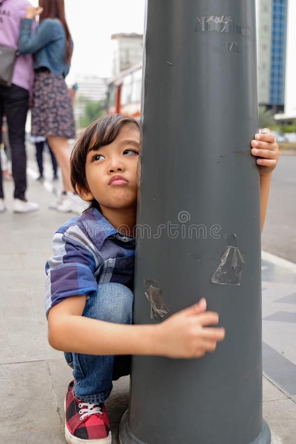 Asian Child Whining and Cranky Demanding for Something During Family Trip royalty free stock image