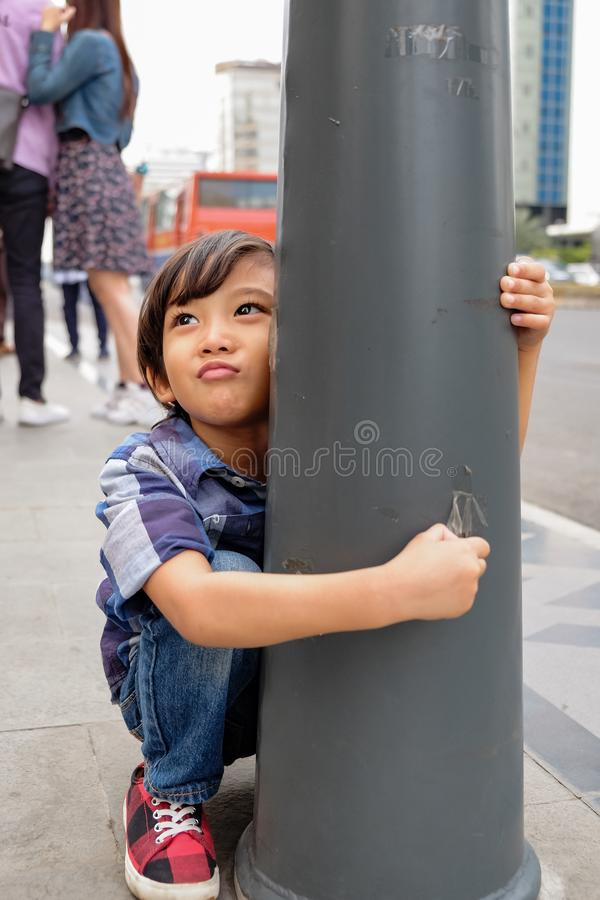 Asian Child Whining and Cranky Demanding for Something During Family Trip stock photo
