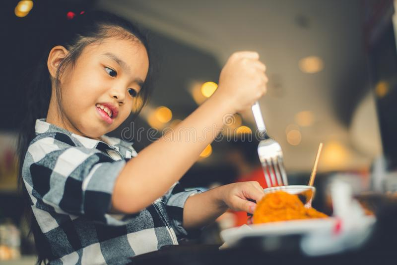 Asian Children Eating Fried Chicken Food Court stock photos