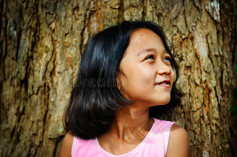 Asian children happiness under a tree royalty free stock images