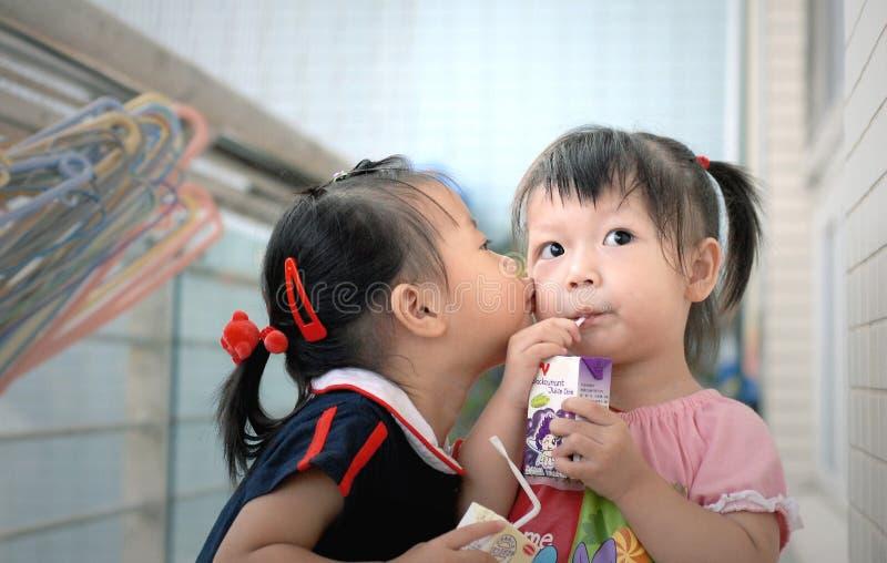 asian children kiss royalty free stock photos