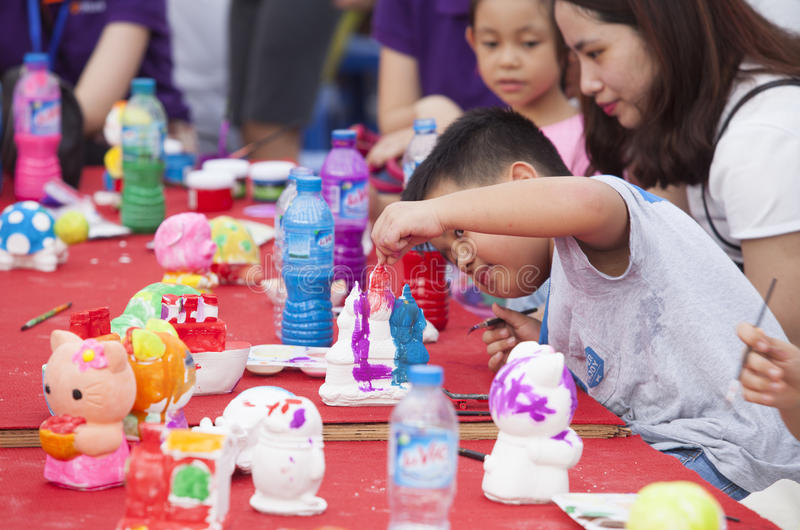 Asian children painting and writing their wishes on wishing cards stock image
