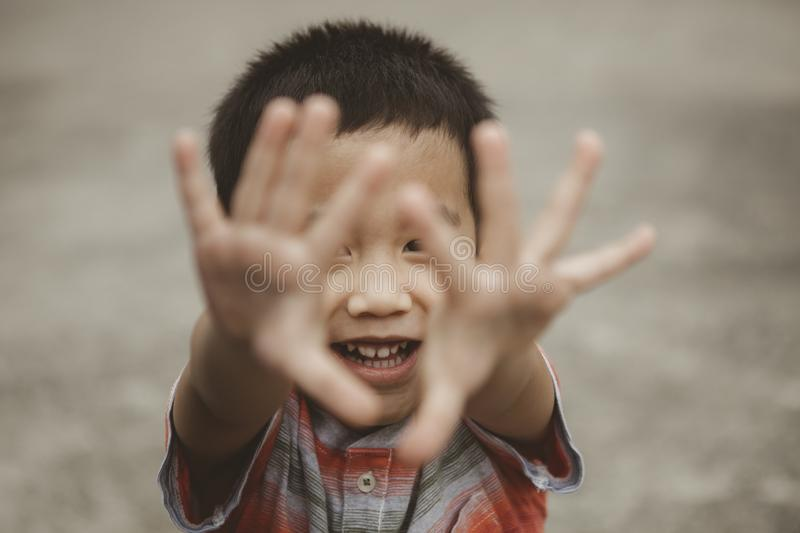 Asian children playing with happiness face stock image