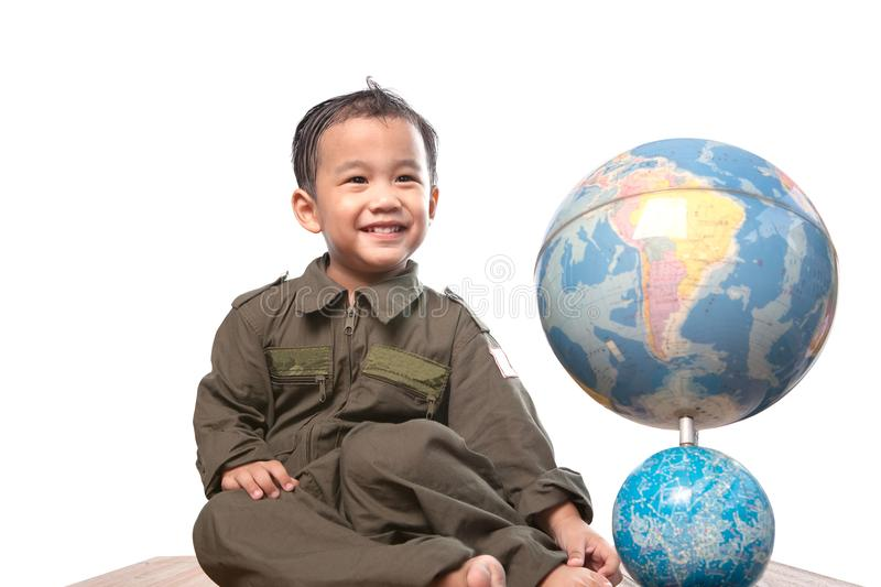 Asian children wearing military pilot suit toothy smiling face w. Ith world globe model isolated white background royalty free stock images