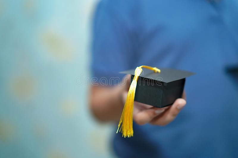 Asian children young kid hold graduation gap in hand. royalty free stock photography