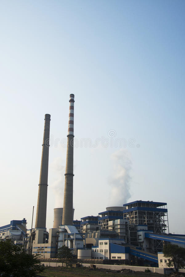 Asian China, Beijing, thermal power plant, equipment, buildings, cooling towers, chimneys. Asian China, Beijing, equipment of thermal power plant, plant factory stock image