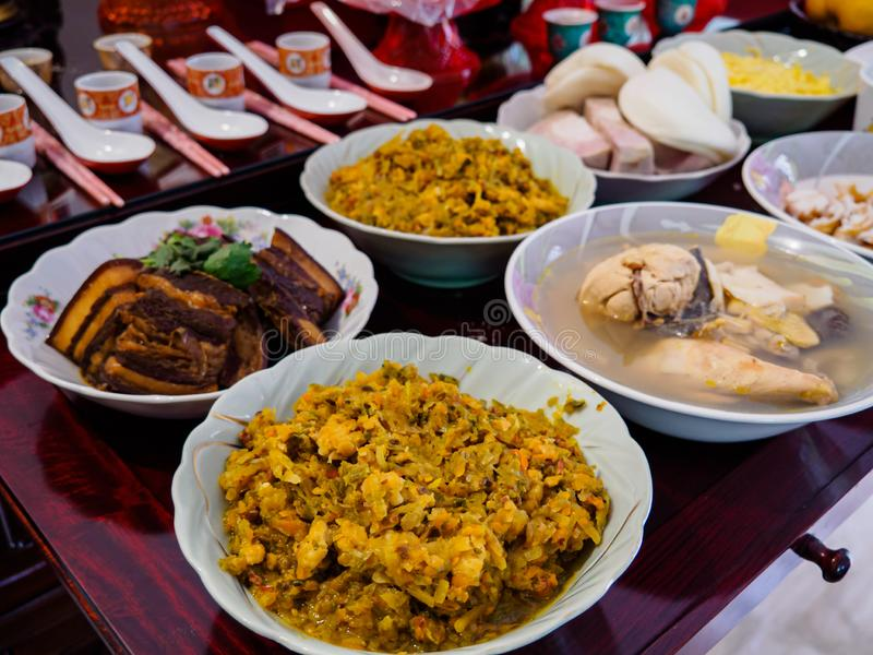 Asian Chinese ancestor worship - food offerings made to ancestors on Dongzhi / Winter solstice. Asian Chinese ancestor worship prayers - food offerings made to royalty free stock photos
