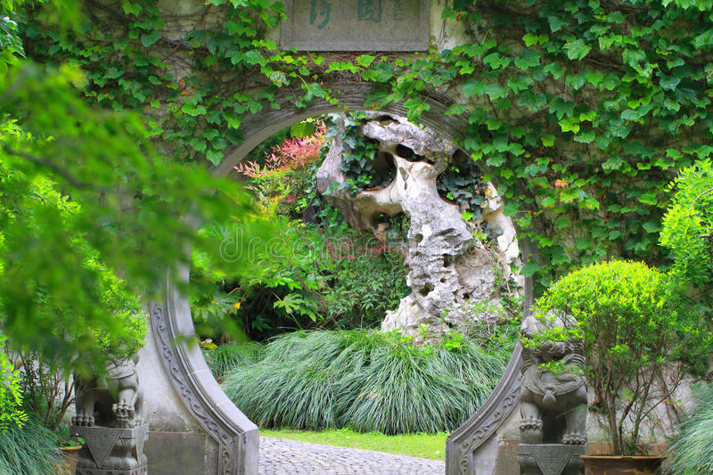 Asian Chinese ancient garden, beautiful landscape, stone archway. royalty free stock photography