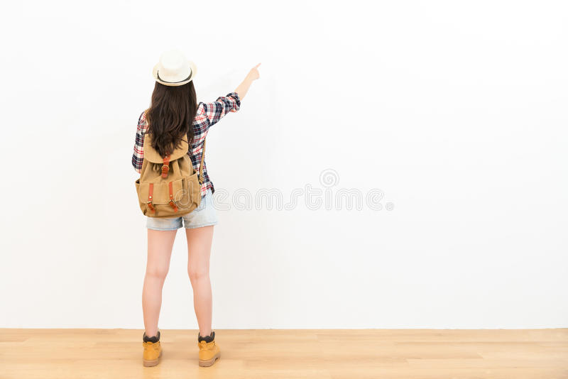 Asian chinese backpacker pointing to the copyspace stock images