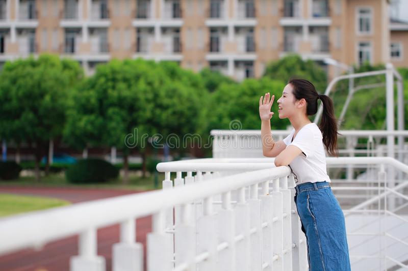 Asian Chinese college student beauty in campus school playground. Pure innocent girl wonderful school time careless age royalty free stock photo