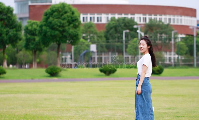 Asian Chinese college student beauty in campus school playground. Pure innocent girl wonderful school time careless age royalty free stock images