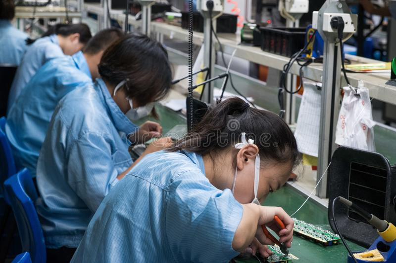 Asian Chinese Electronics Factory Workers Female Industry Manufacturing Assembly Line royalty free stock image