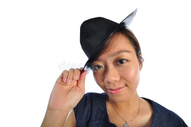 Asian chinese girl with bowel hat. Beautiful young Asian Woman picture taken from the top to give a big doll head effect stock photography