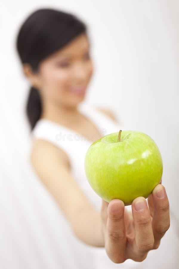 Asian Chinese Girl Holding Fresh Green Apple stock photo