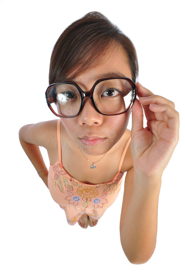 Asian chinese girl looking stern. Beautiful young Asian Woman picture taken from the top to give a big doll head effect royalty free stock image