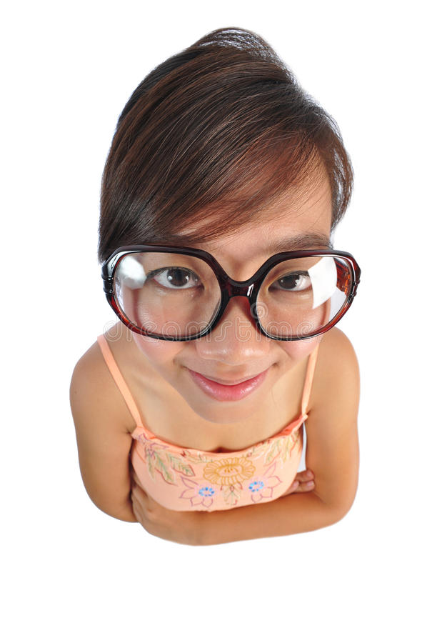 Asian chinese girl looking stern but smiling. Beautiful young Asian Woman picture taken from the top to give a big doll head effect stock image