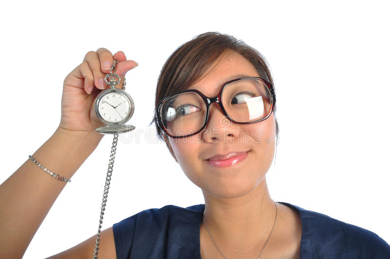 Asian chinese girl looking at Time. Beautiful young Asian Woman picture taken from the top to give a big doll head effect stock images