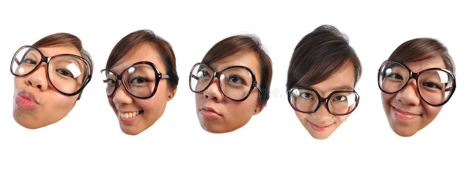 Asian chinese girl making funny doll faces. Beautiful young Asian Woman picture taken from the top to give a big doll head effect royalty free stock images