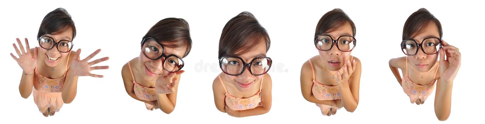 Asian chinese girl making funny doll faces 2. Beautiful young Asian Woman picture taken from the top to give a big doll head effect stock photos