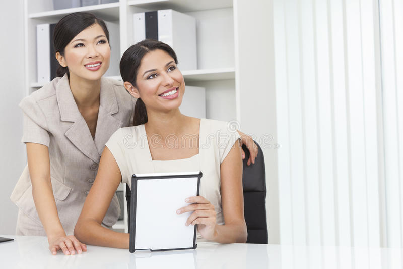 Asian Chinese & Hispanic Businesswomen Using Tablet Computer royalty free stock images