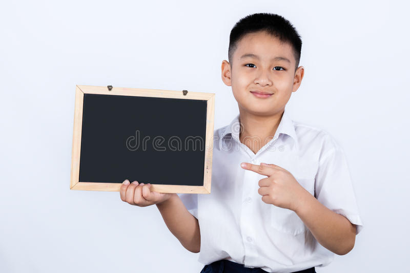 Asian Chinese Little Boy Wearing Student Uniform Pointing Chalkboard stock image