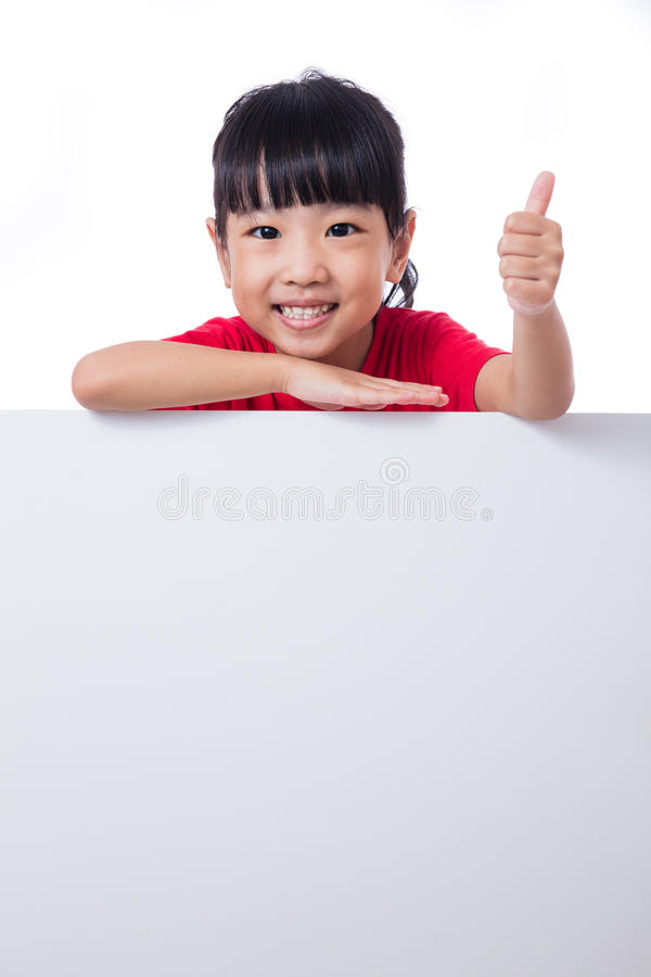 Asian Chinese little girl behind a blank white board. In isolated white background stock images