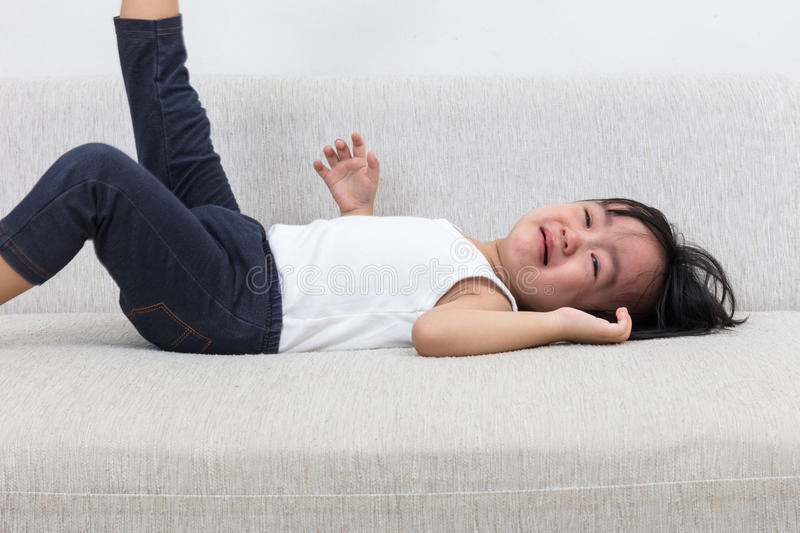 Download Asian Chinese Little Girl Crying On The Sofa Stock Photo - Image: 83705106