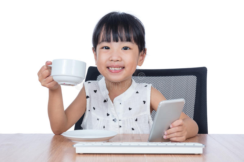 Asian Chinese little girl drinking coffee stock photo