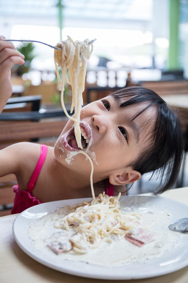 Free Asian Chinese Little Girl Eating Spaghetti Royalty Free Stock Image - 116791766