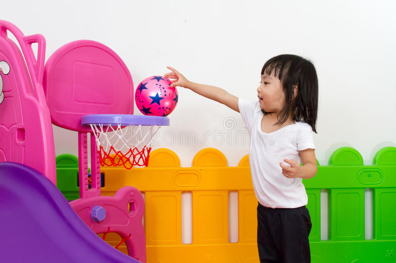Asian Chinese little girl playing basketball royalty free stock images