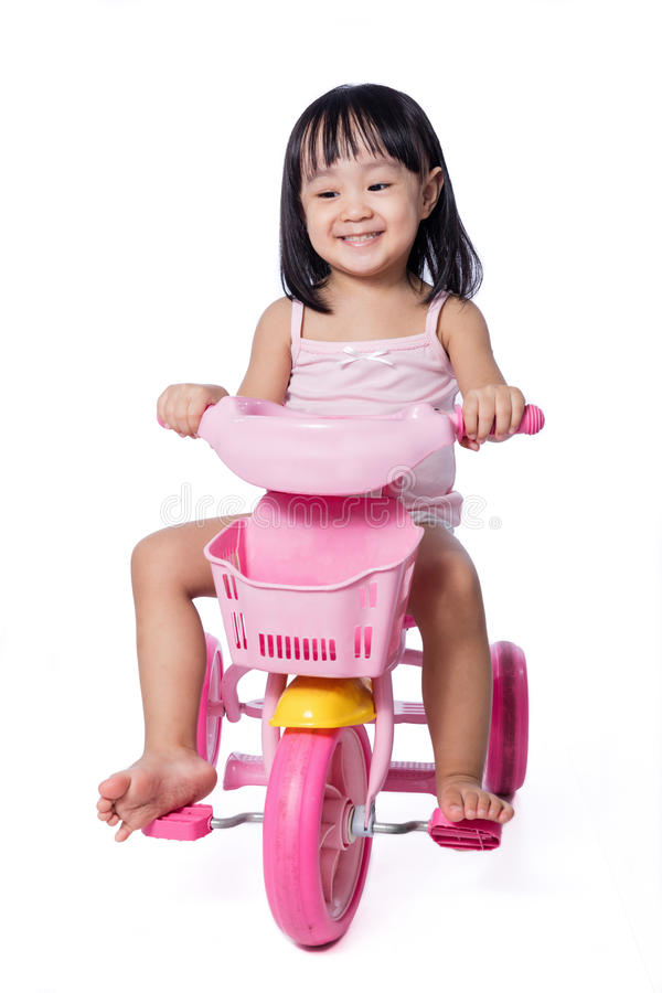 Free Asian Chinese Little Girl Riding A Toy Tricycle Royalty Free Stock Photo - 90474145
