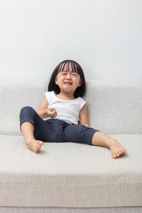 Download Asian Chinese Little Girl Sitting On The Sofa Crying Stock Image - Image: 83706187